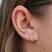 Gold Crystal Huggie Hoop Earring on Model